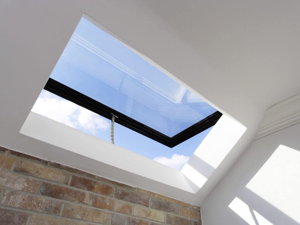 Hinge-opening pitched rooflight