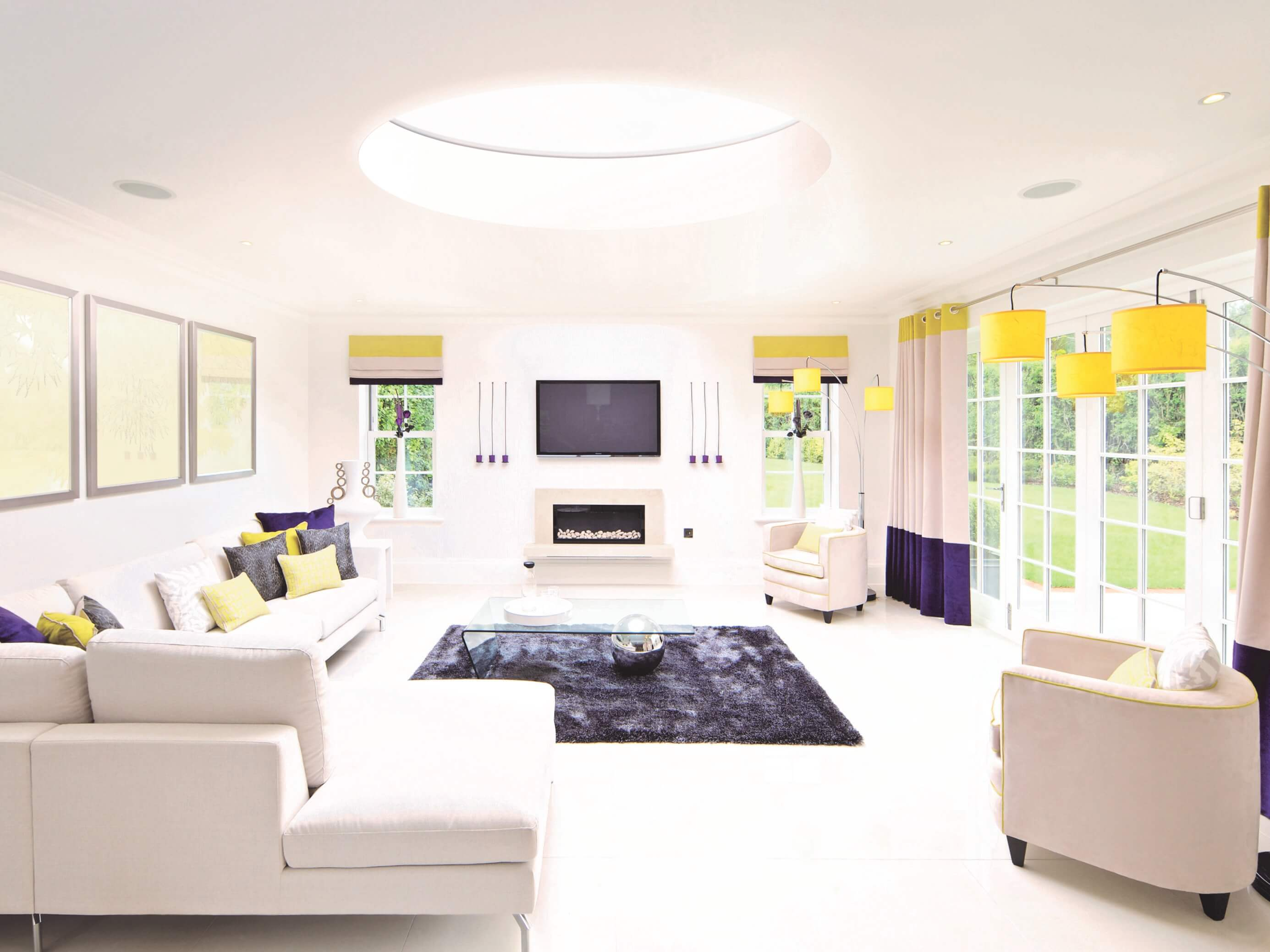 Round 'O-Lite' rooflight above a contemporary lounge